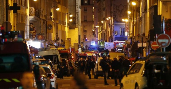 Security men take position in Paris on Friday night