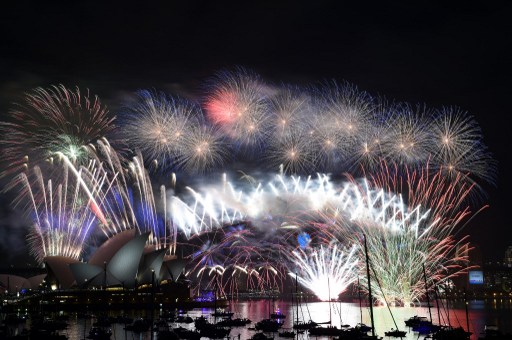 File:  fireworks over Sydney's iconic Harbour Bridge and Opera House during the traditional fireworks at midnight on January 1, 2015.