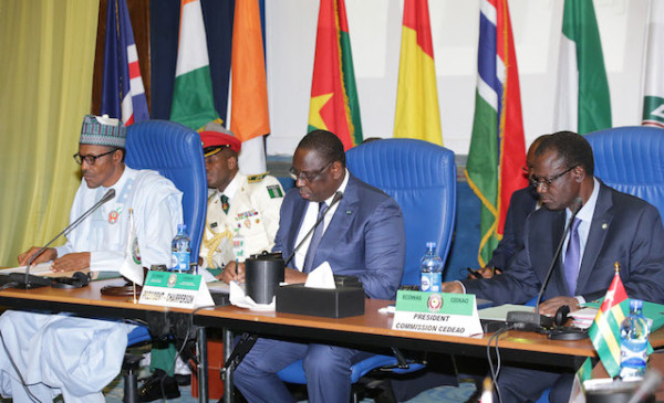 L-R; President Muhammadu Buhari, Chairperson and President of Republic of Senegal, Mr Macky Sall and President of ECOWAS Commission, Mr Kadire Desire Ouedraogo during the opening of the 48th ordinary session of the ECOWAS Authority of Heads of State and Government held at the Transcorp Hilton Abuja. PHOTO; SUNDAY AGHAEZE.