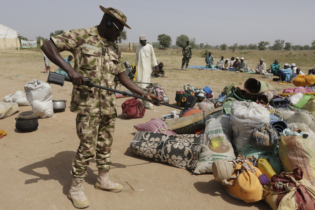 Soldiers screen newly arrived displaced people at Furore camp in Yola . AP Photo