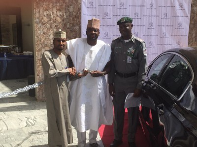 Kunle Afolayan with Ibrahim Boyi, MD, PAN and an officer of Nigerian Air Force as he received his official car