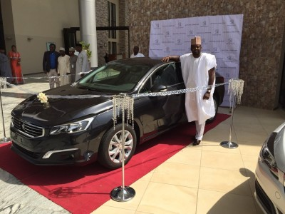 Afolayan with the new Peugeot 508 model