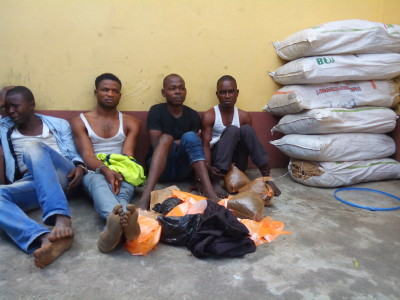 The suspects and some of the bags of Indian hemp
