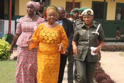 Mrs Lola Akande and other officials of the  ministry being escorted to their cars by the officer in charge of female  prisoners in Kirikiri, Lagos, Mrs Ekpendu Lizzy.
