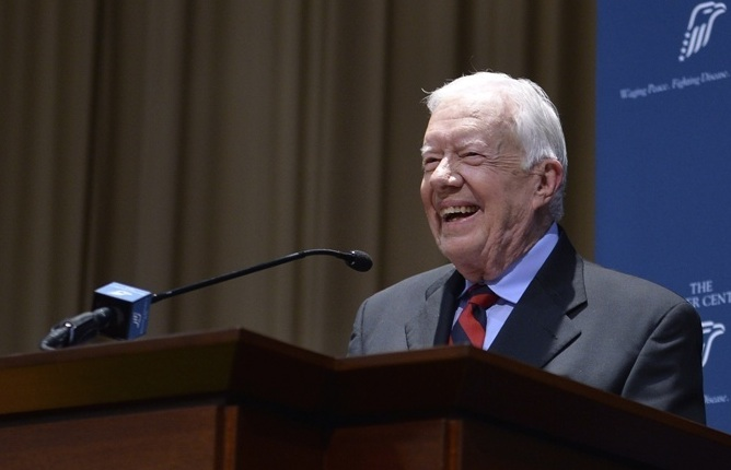 Jimmy Carter: says he is now cancer free