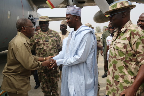 Minister of Information and Culture Alh. Lai Mohammed being received by the Deputy Governor of Borno State, Alh. Usman Durkwa and the Theatre Commander, Operation Lafiya Dole, Maj. Gen.  Y. M. Abubakar upon his arrival at the Air Force Base Maiduguri to visit  some towns liberated by the military from Boko Haram.
