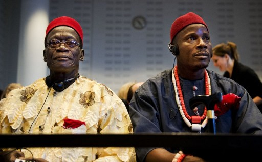 Four Nigerian farmers (L to R)  Nigerian farmers Chief Fidelis A. Oguru-Oruma (L) and Eric Dooh sit in the law courts in The Hague on October 11, 2012. The Four  farmers take on Shell in a Dutch court , accusing the oil giant of destroying their livelihoods in a case that could set a precedent for global environmental responsibility.