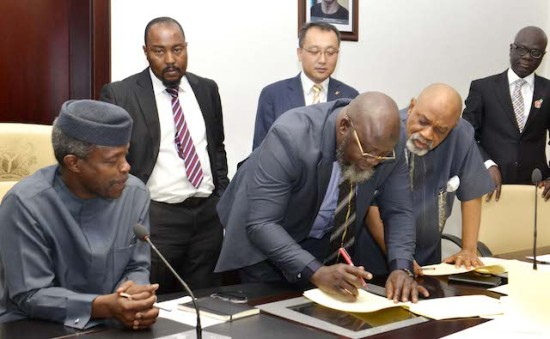 Adebayo Shittu signs the MoU. With him, Chris Ngige, Minister of Labour
