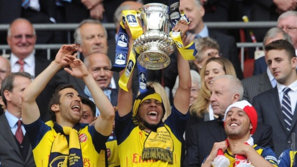 Gunners with the FA Cup last year