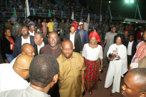 Wike meeting guests at the carol