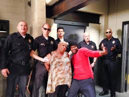 Atuma with Actress Luenell (playing the role of Mylanta) and Actor Brian Hooks (playing the role Jamal) with the other LAPD Officers