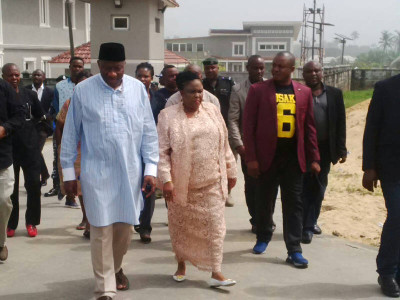 Mr and Mrs Jonathan stepping out of their house to exercise their franchise
