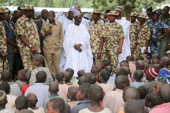 Mohammed  addressing children at the Internally Displaced Persons Camp in Bama