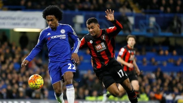 A midfield struggle for the ball with Chelsea's Willian