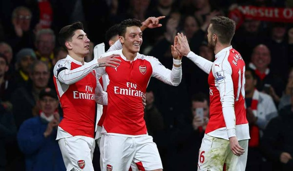 Ozil being congratulated by team mates
