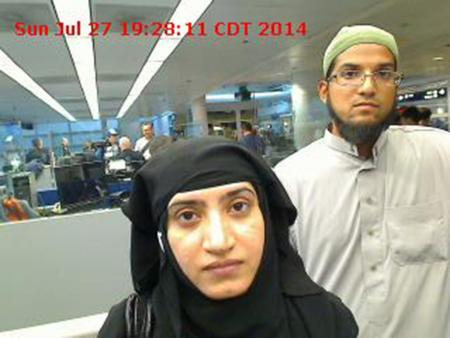 Tashfeen Malik, (L), and Syed Farook are pictured passing through Chicago's O'Hare International Airport in this July 27, 2014 handout photo obtained by Reuters