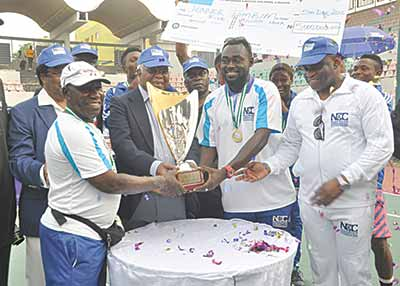 Former Vice President, Dr. Alex Ekwueme (third right), Team Tombim Captain, Henry Atseye (second right), Coach, Babatunde Abbey and NCC Director, Public Affairs, Tony Ojobo (right), during the presentation of the trophy to Team Tombin at the end of the maiden NCC Tennis League in Lagos…at the weekend. Photo credit: The Guardian