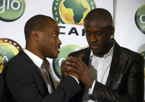 Nigerian goalkeeper Vincent Enyeama (L) congratulates Ivorian skipper Yaya Toure after winning the CAF African Footballer of the Year Award in Lagos on January 8, 2015.