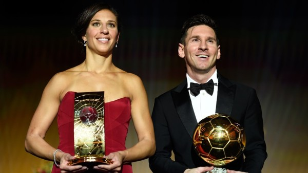 Carli Lloyd and Messi with their trophies on Monday night