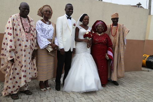 Parents of the couple take photo with the new couple, Mr and Mrs Adefemi Mohammed Onanuga