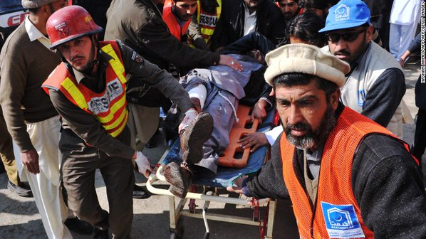 Rescue workers carry the injured at Bacha Khan University after Taliban's terror strike