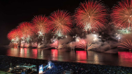 Fireworks for a New Year's celebration launch from boats at Copacabana beach in Rio de Janeiro