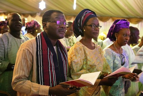 From left, Kunle Ajibade and his wife with another  guest at the church