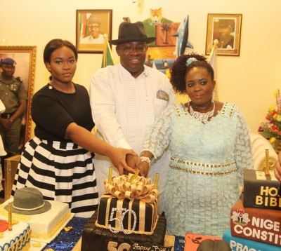 Bayelsa State Governor, Hon. Seriake Dickson (2nd left) assisted by his wife, Rachael (2nd right) jointly cutting the Governor's 50th birthday cake during a reception at Toru-Orua in Sagbama Local Government Area of the State, while the Chairman of the State Traditional Rulers Council, His Majesty, King Alfred Diete Spiff (right) and HRH. King Amalate Turner (left) look on