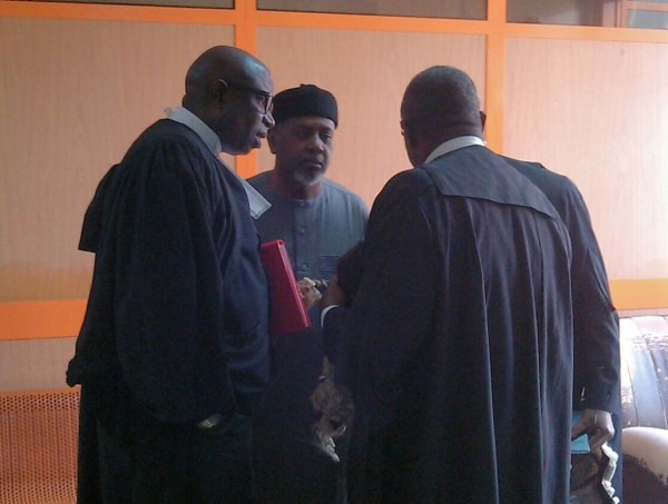 Dasuki, second right, and his lawyers this morning