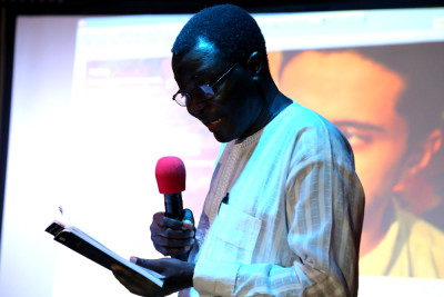 Kunle Ajibade reading from his book entitled Jailed for Life at the  reading