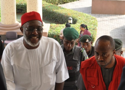 Olisa Metuh smiling into the court room