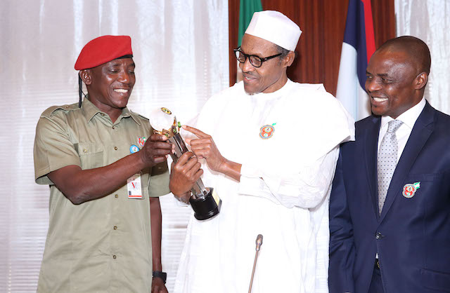 Buhari  receives the Glo-CAF platinum award from Sports minister, Solomon Dalong