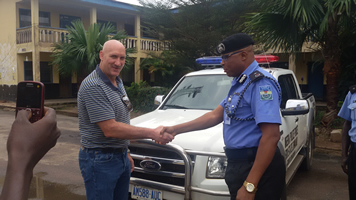 The Managing Director, Okomu Oil Company, Dr. Graham Hefer presenting the key of a Patrol Van donated to Edo State Police Command by the Company the Deputy Commissioner of Police in charge of Operations, Mr Kenneth Ebrimson in Benin City.