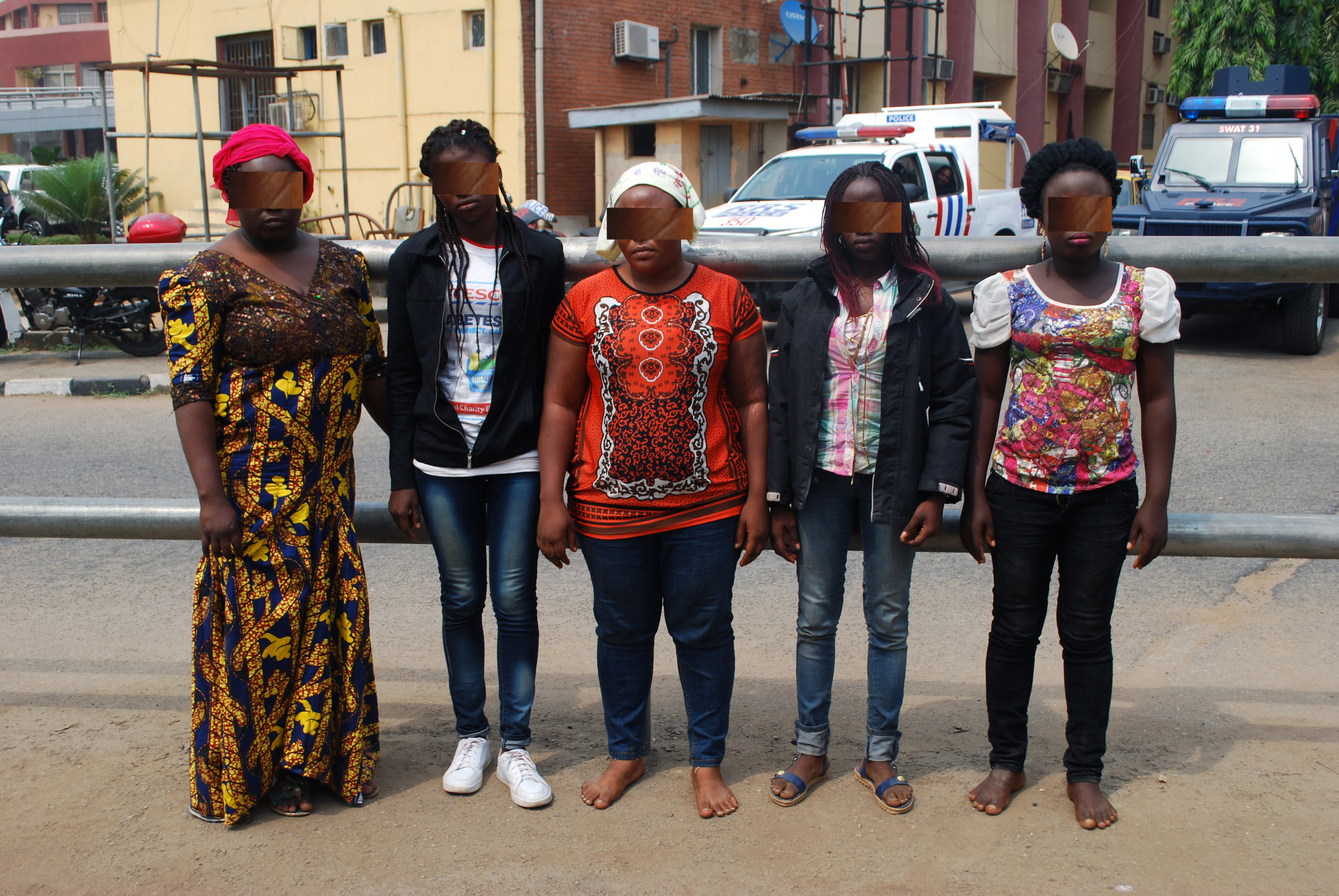 The trafficker ( left) and her four victims