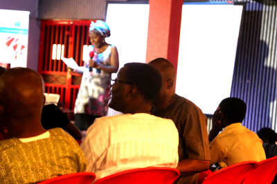 Yemi Afolabi reading a poem from Fayadh book at the event