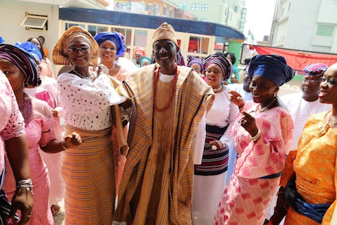 Father of the groom, Babatunde Onanuga being ushered into the reception hall