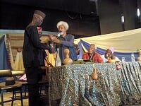 Wole Soyinka presented Vodka and other gifts to Biodun Jeyifo while others watche in  admiration