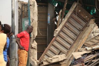 One of the owners look at what remains of his shop