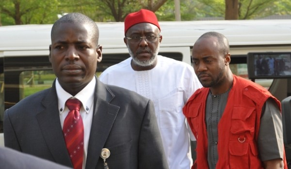 Olisa Metuh and his silver grey beard with EFCC operatives