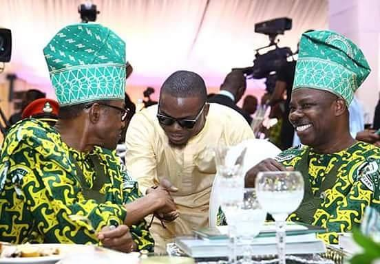 Olamide, middle, gets presidential handshake from President Buhari, left. Right is Governor Ibikunle Amosun