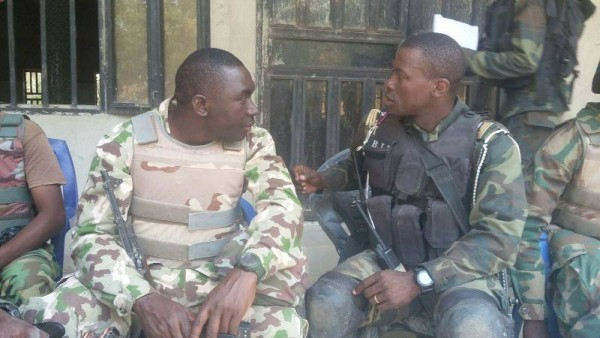 Lt. Col. Georgi Kwene, right, with  his Nigerian  counterpart before the mine accident
