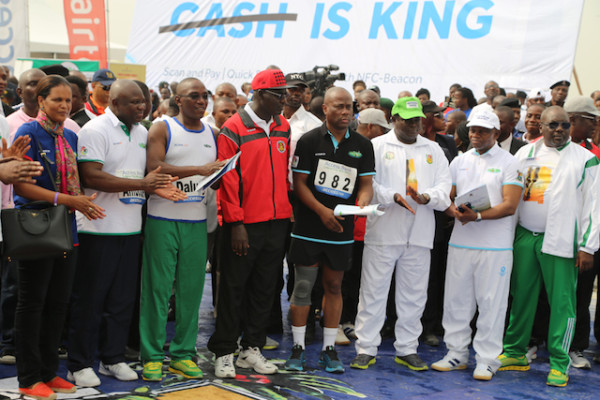 Governor Ambode, second left, and other VIPs at the finish line