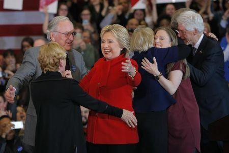 Hillary Clinton celebrates with former U.S. Senator Tom Harkin (L), her daughter Chelsea (2ndR) and her husband, former President Bill Clinton (R), at her caucus night rally in Des Moines, Iowa