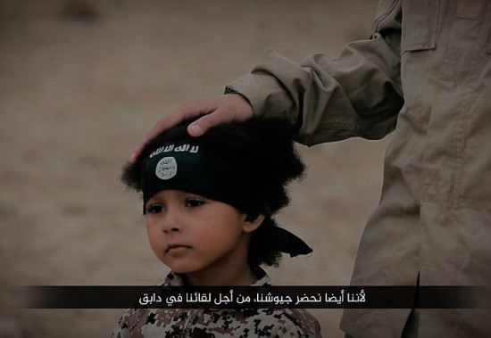 Isa Dare with masked ISIS militant