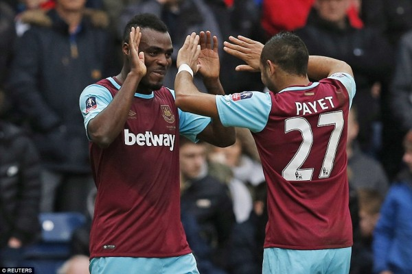Emenike, left being congratulated by team mate