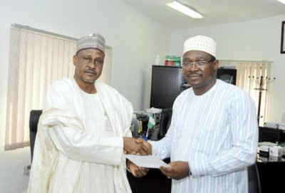 Ahmed Abdu (L) takes over from Babatunde Kuye as Acting Director-General, Bureau of Public Procurement (BPP)