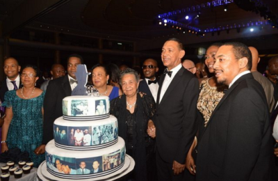 Bruce with his family about to cut the birthday cake