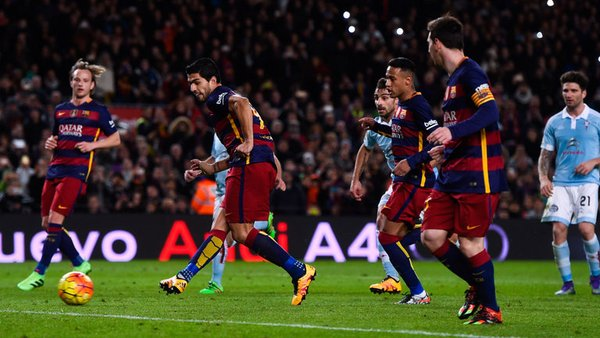 Luis Suarez rushes in to kick the ball into the net