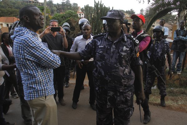 Kizza Besigye, right, arrested by the police after voting