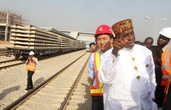 Amaechi, in white, inspecting one of the railway projects